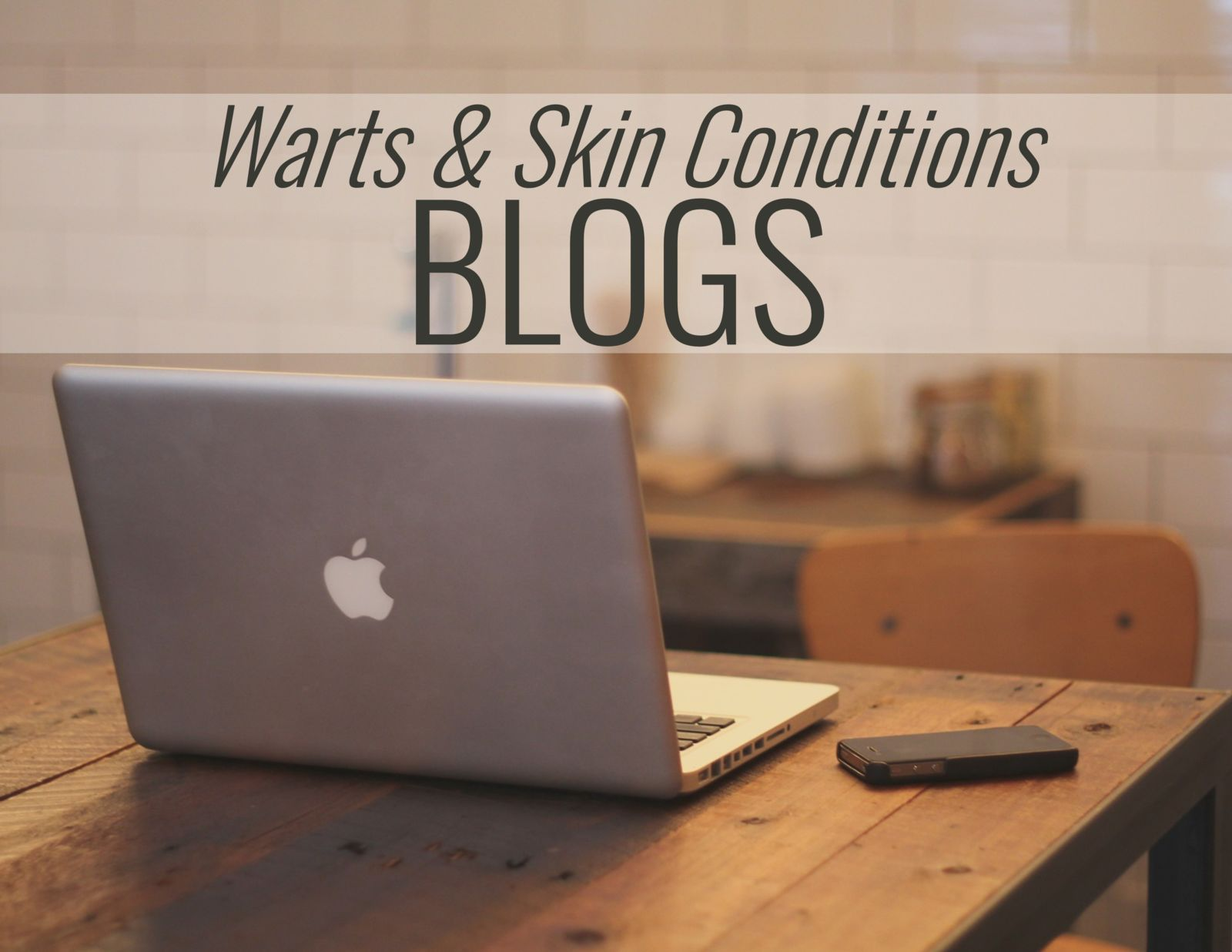 computer on a desk and the words: Warts & Skin Conditions BLOG