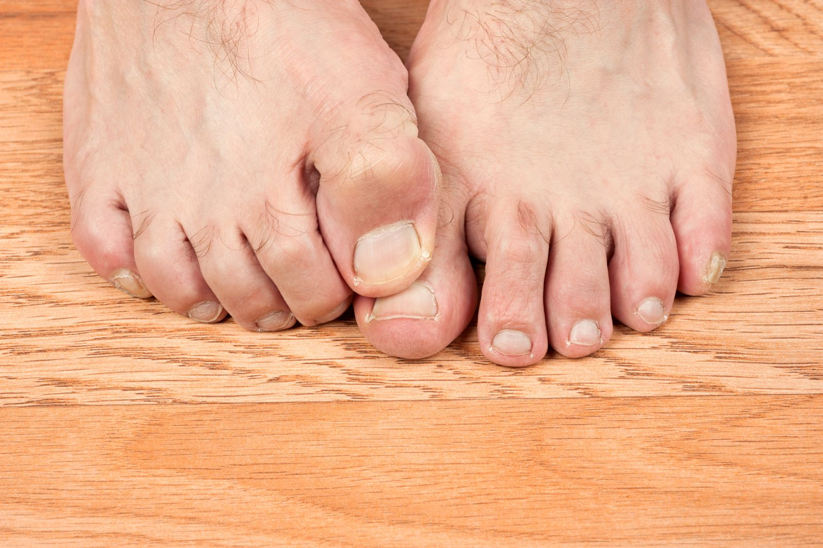 Standing on hard surfaces all day can make foot pain worse--try to find a carpet or mat that can soften the blow