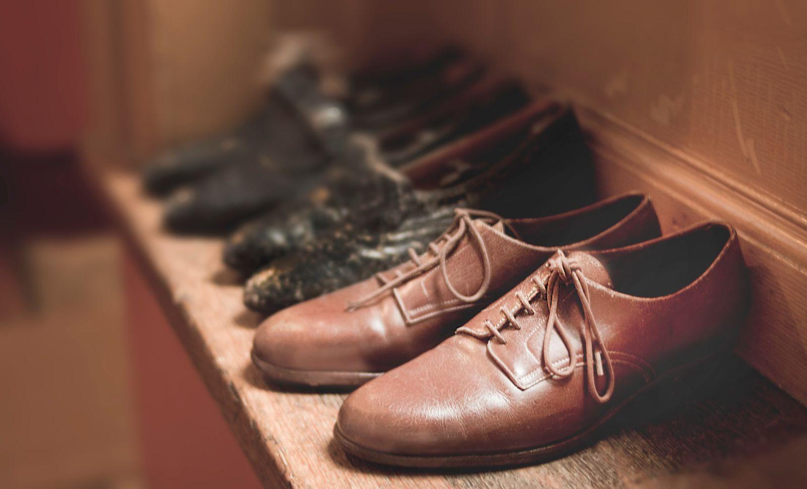Mens brown dress shoes on a shelf