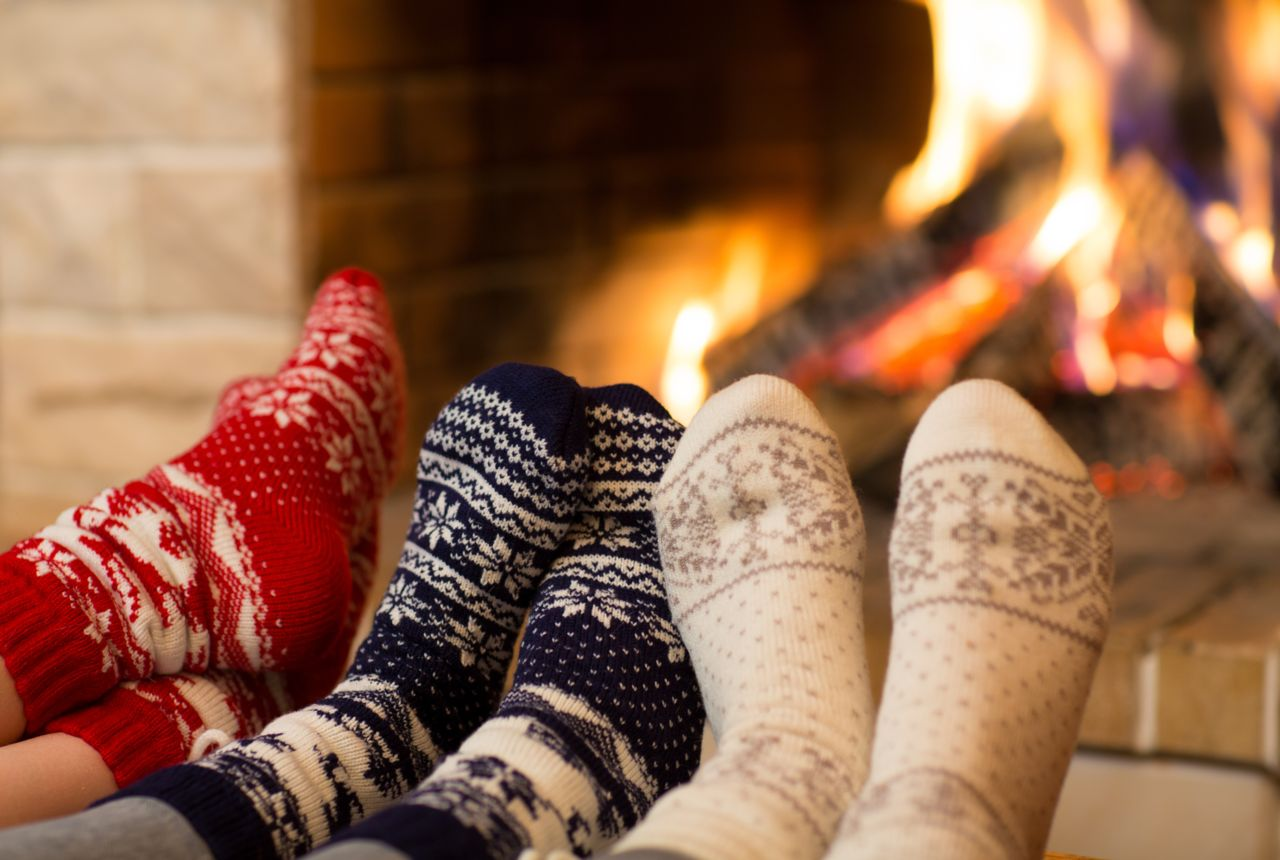 Gradually warming your feet with socks and a fire is better than rapidly reheating feet in hot water or against a radiator