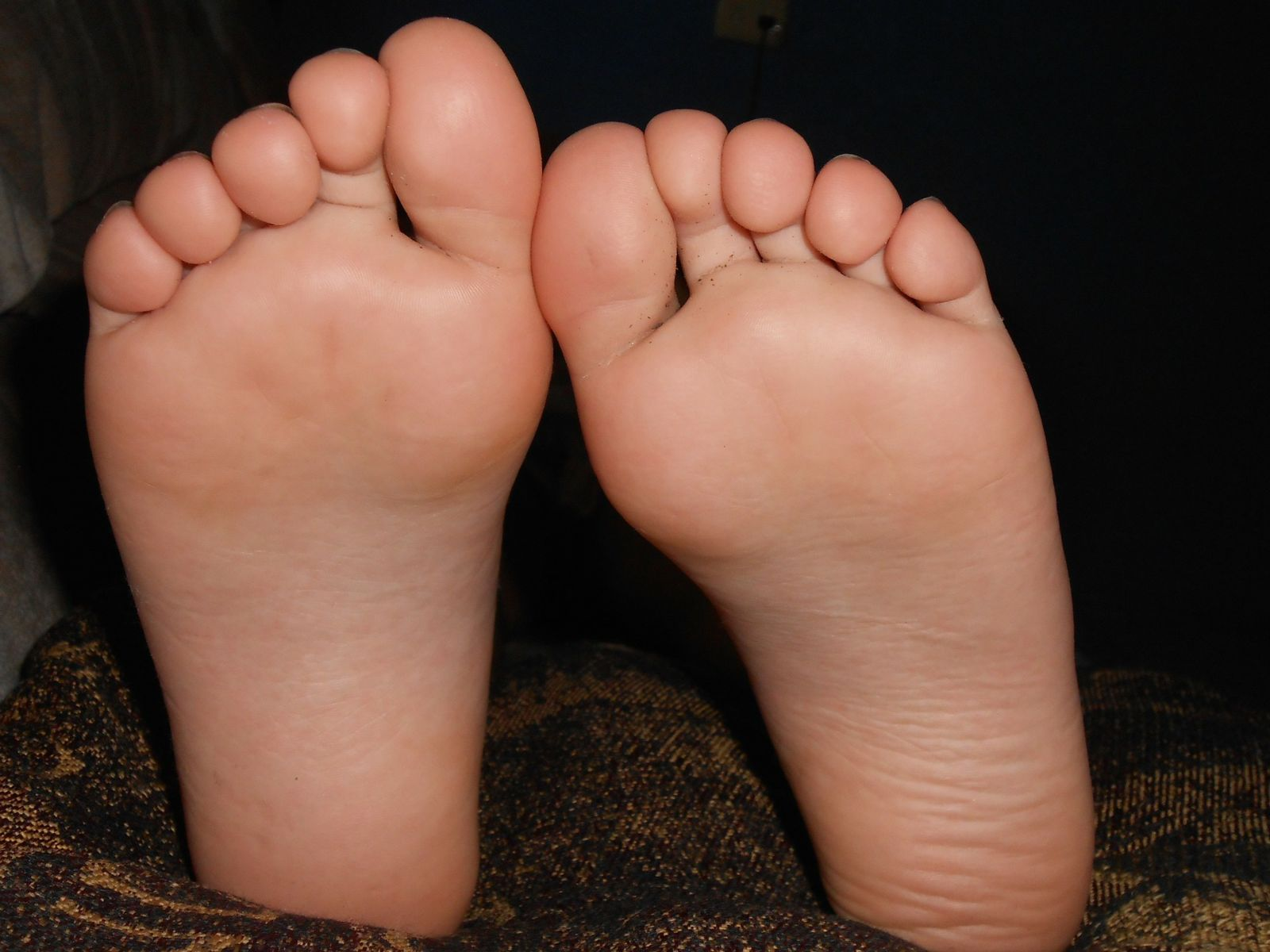 Baby's feet do best when left barefoot to explore the sensation of standing and walking