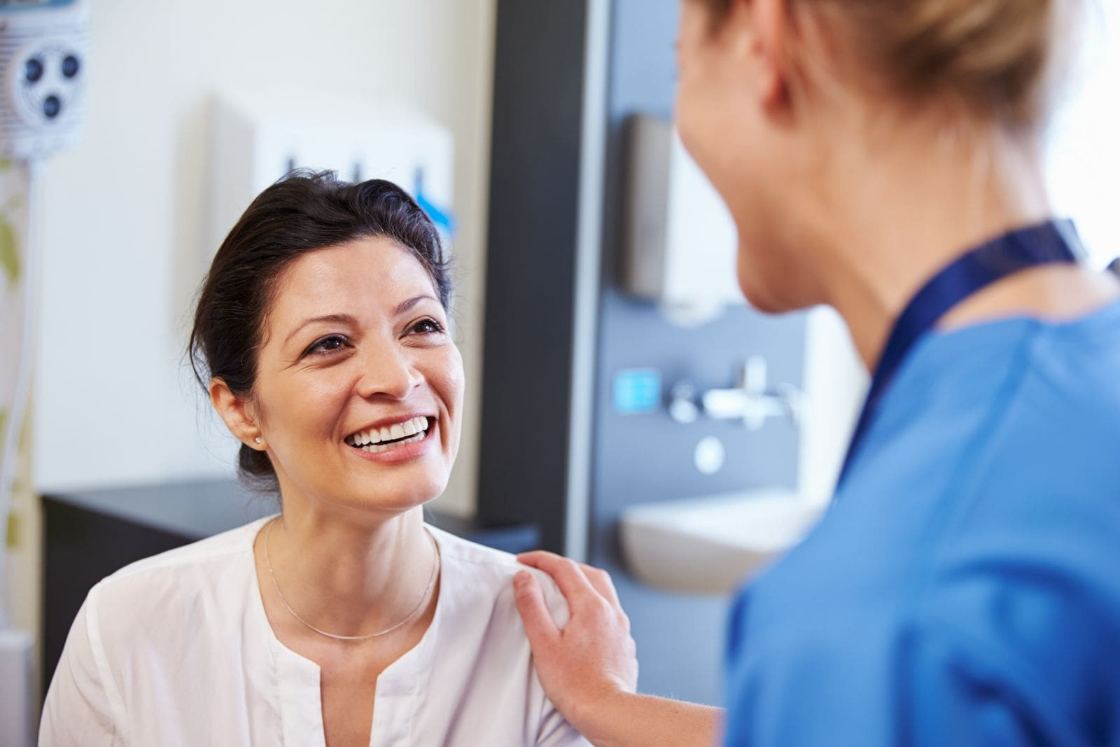 A female doctor talking with a female patient