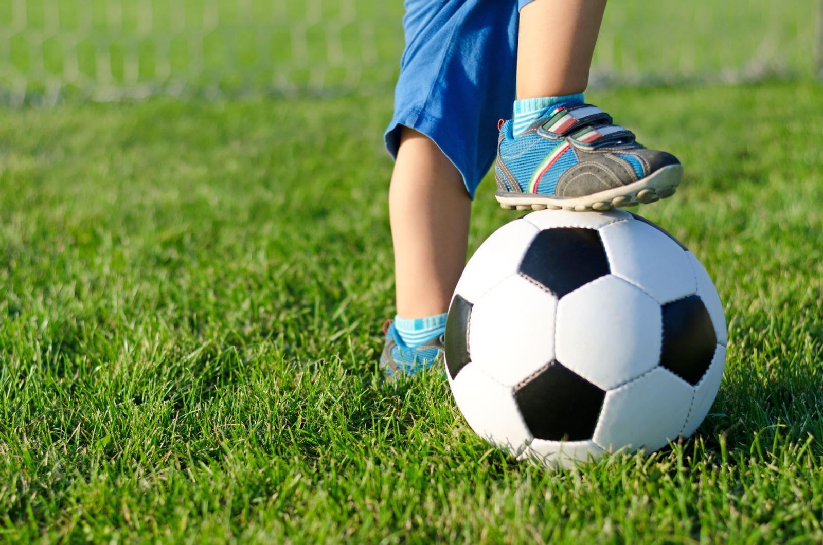 kids foot on soccer ball