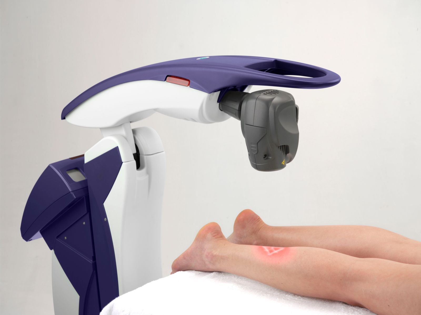 a laser maching and a persons lower legs being treated