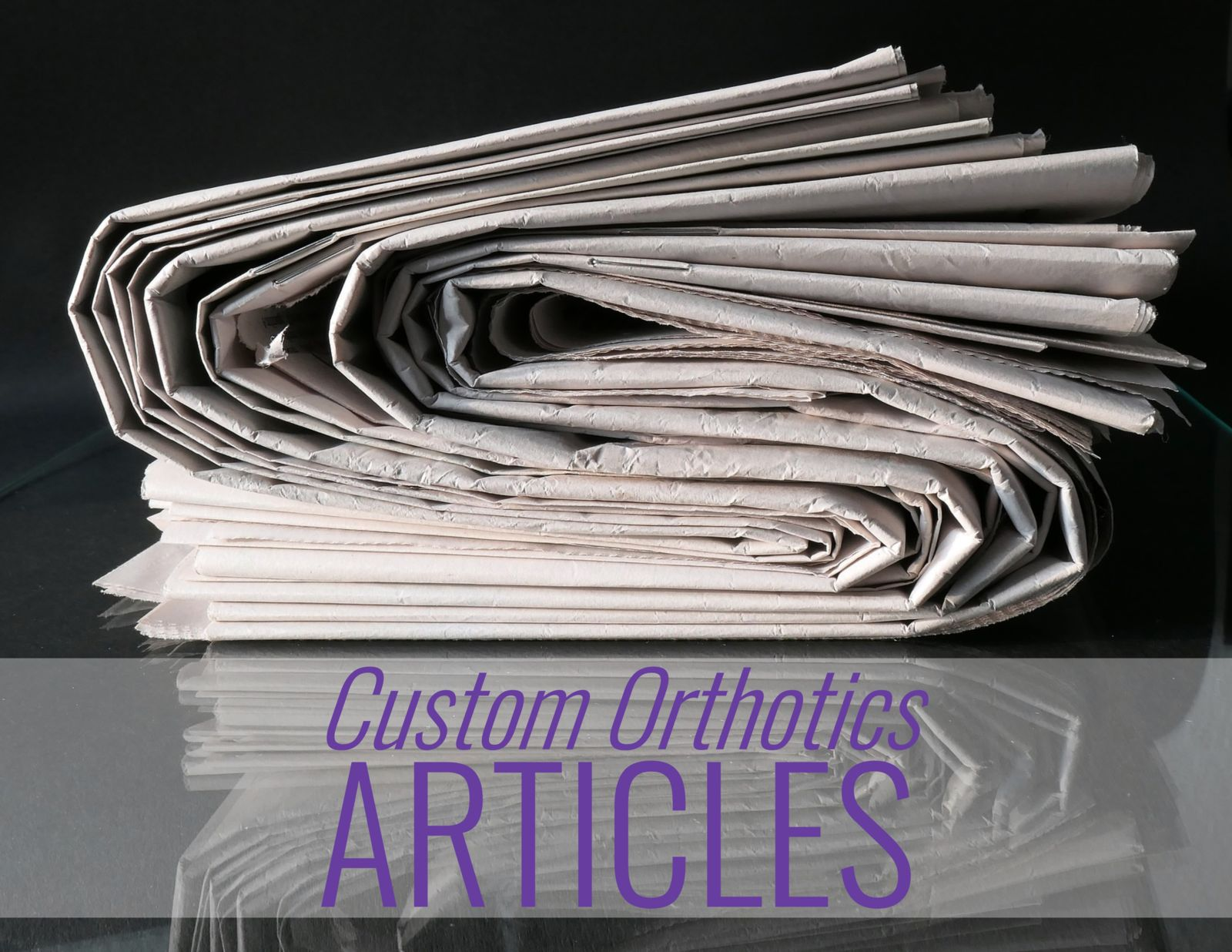 newspapers with the words: Custom Orthotics Articles