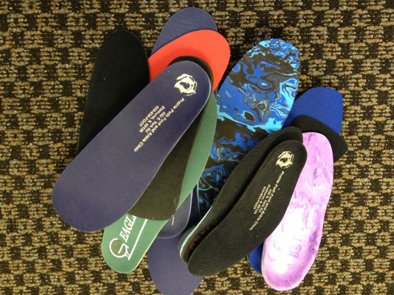 different types of orthotics in a pile