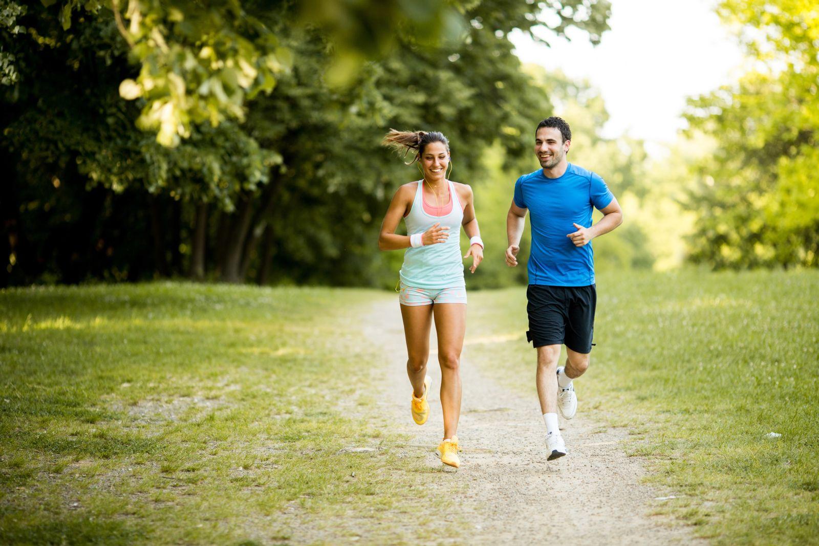 couple running on path
