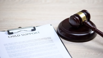 Child Support Paperwork and Judge's Gavel