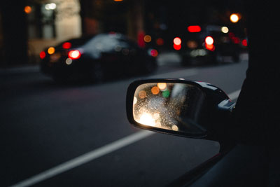Driver looking in side mirror
