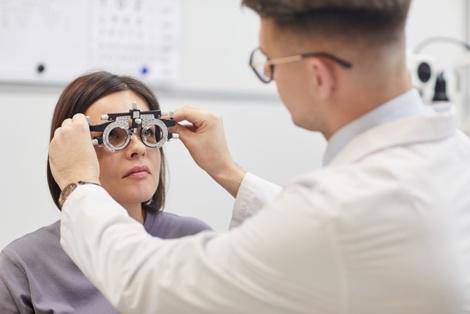 doctor giving eye exam