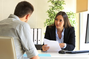 A social security attorney working with a client.