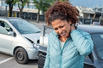 Woman Suffering From Whiplash After a Car Wreck