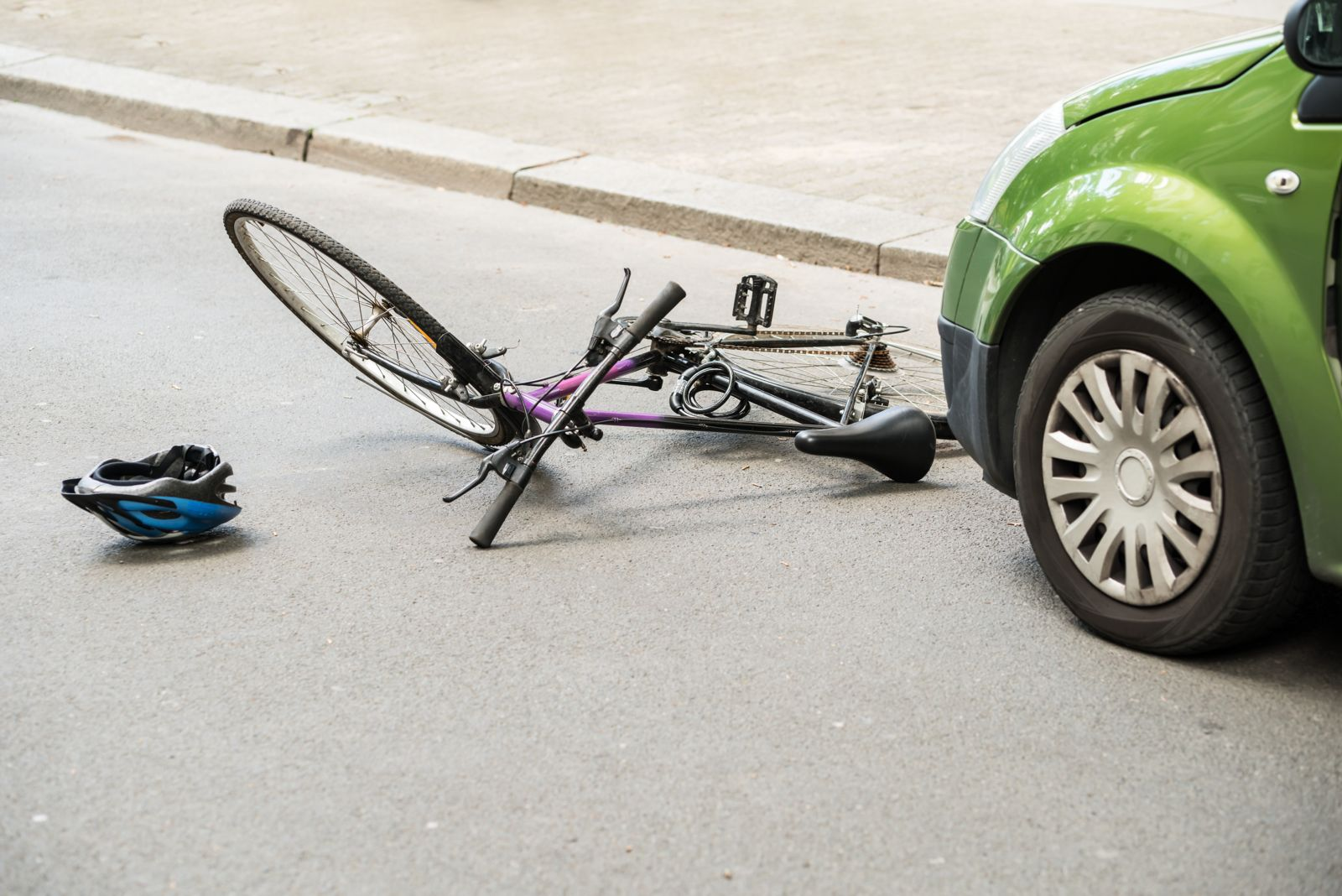 Bicycle on Road After Accident With Car
