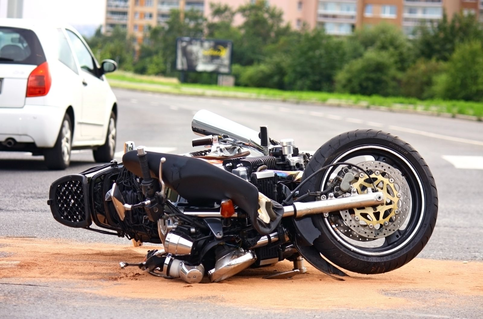 Damaged Motorcycle on Road After Accident
