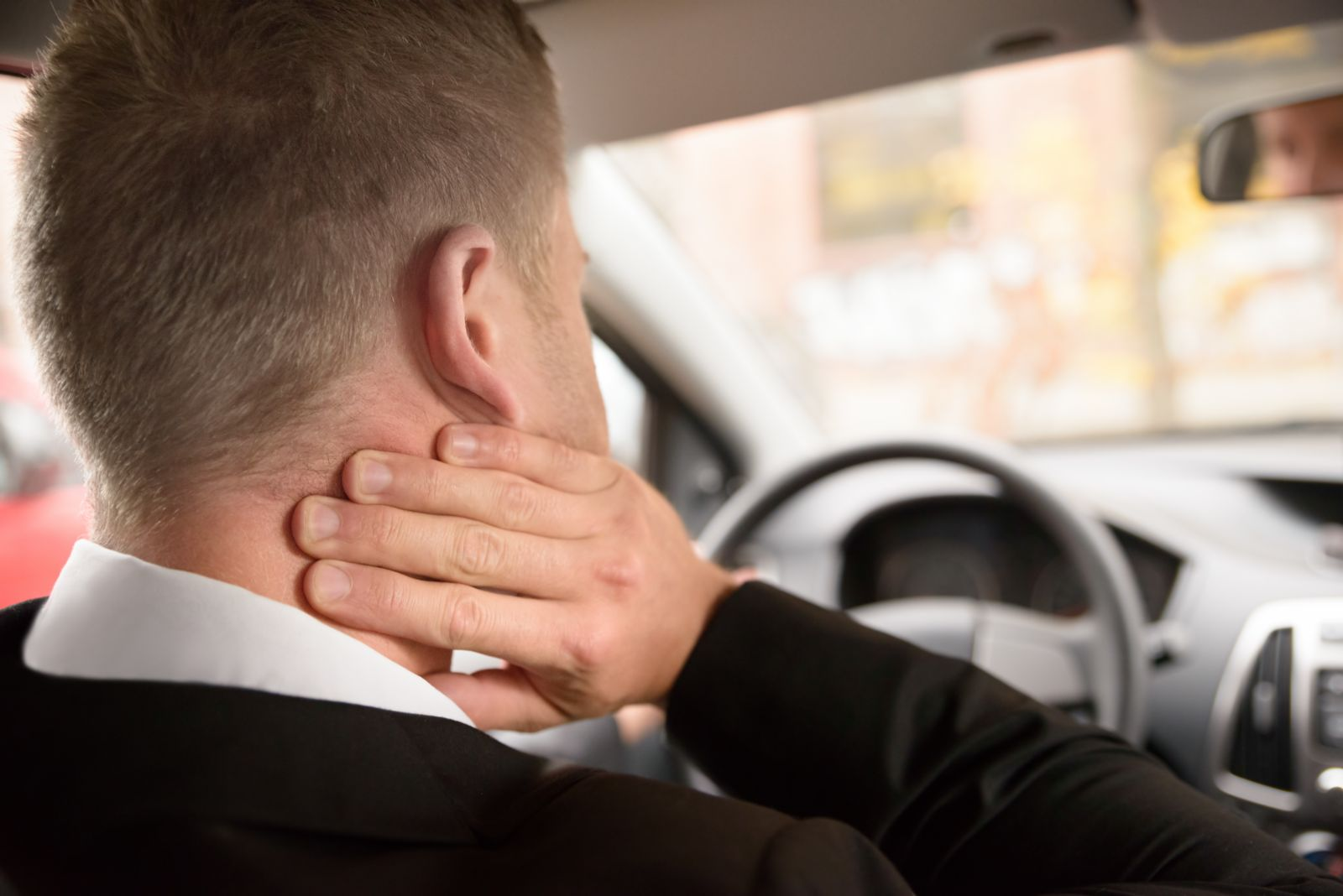 Man Holding Neck While Driving