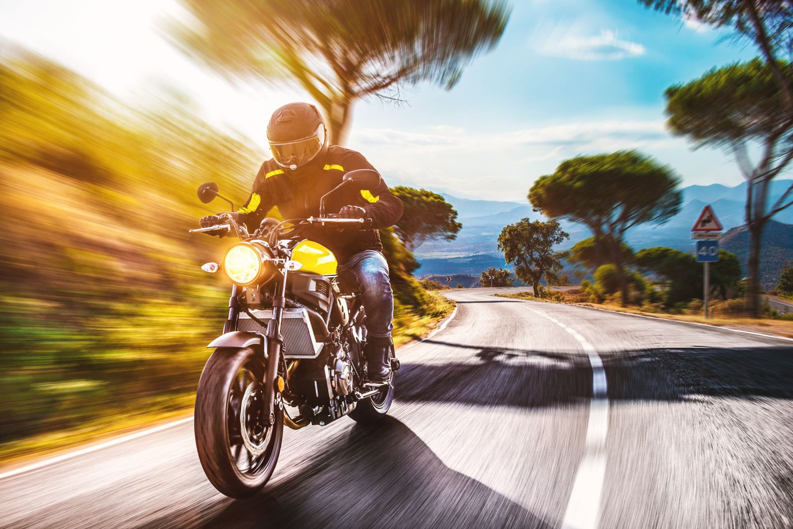 Motorcylclist Riding on Winding Road
