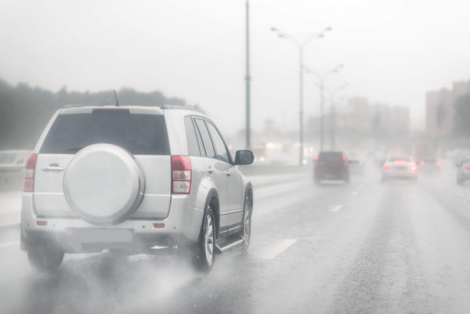 SUV Driving on Wet Road in the Rain
