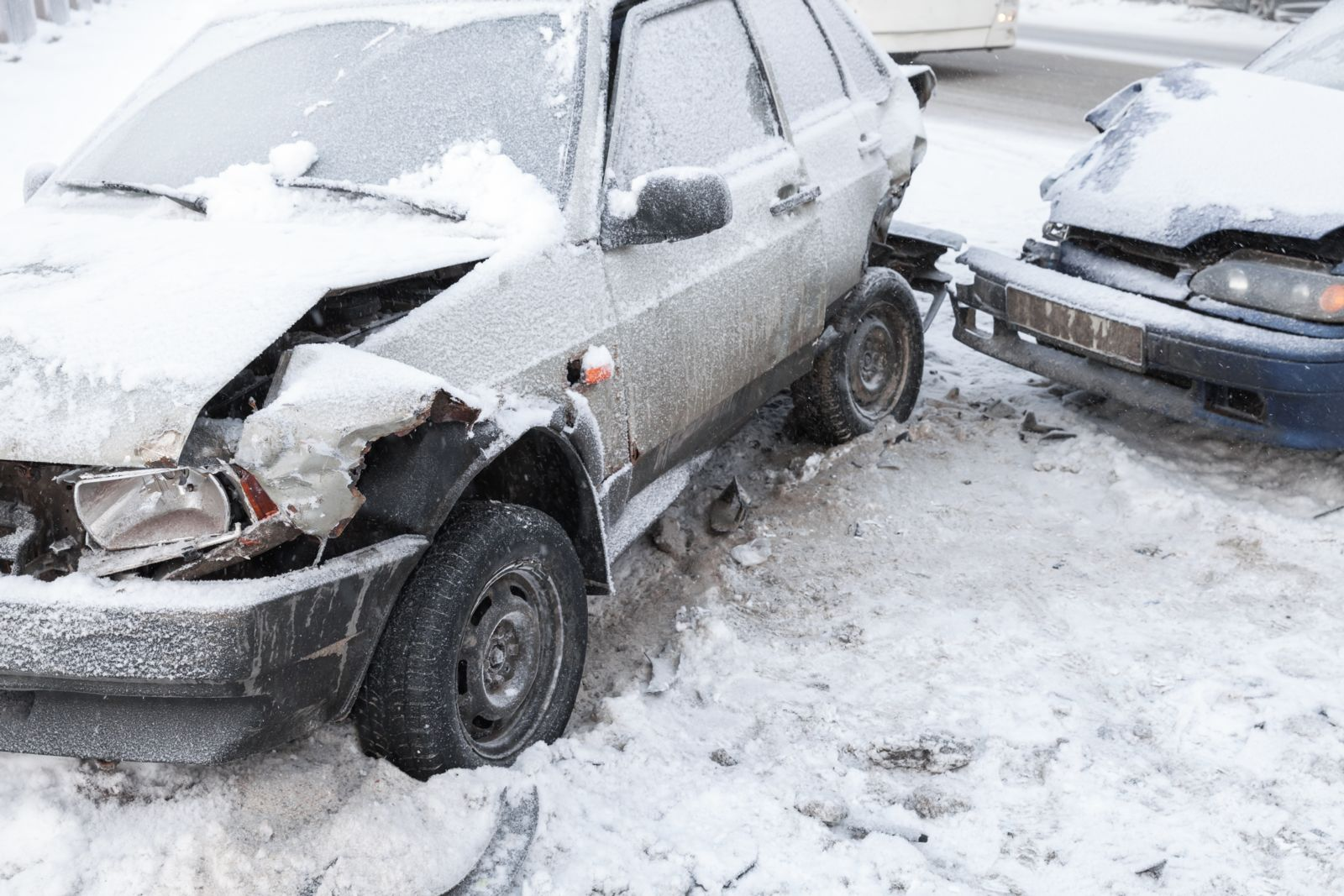 Two Cars After Car Accident in Snow