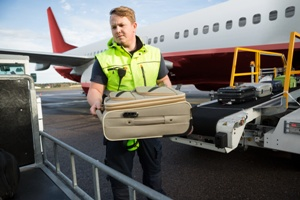 baggage handler at airport workers comp injuries Chris Hudson and Associates