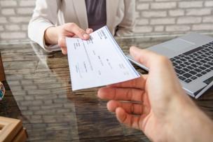 truck accident victim receiving compensation check