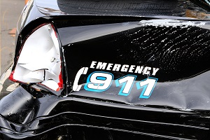 A police car has been damaged in a collision with a civilian vehicle