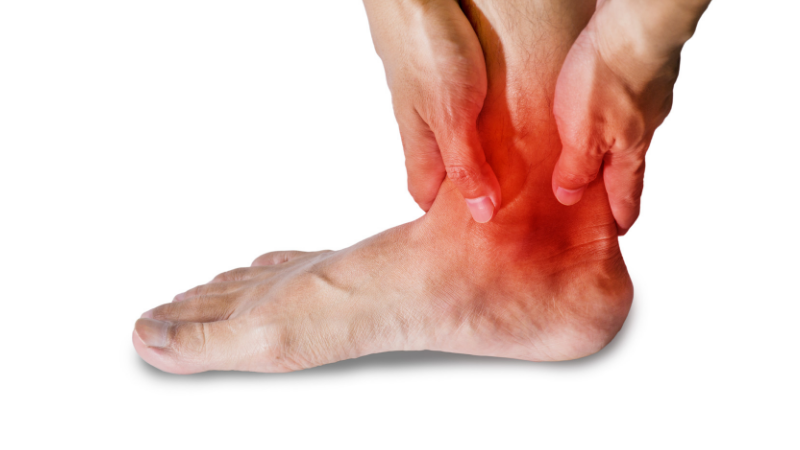 person experiencing pain the back of heel and achilles tendon