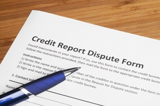 Credit Report Dispute Form With a Pen