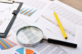 Credit Report Information With a Magnifying Glass