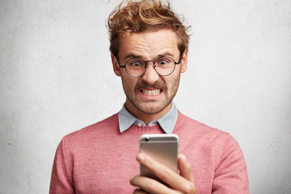 Phone User Frustrated With Slow Loading Times