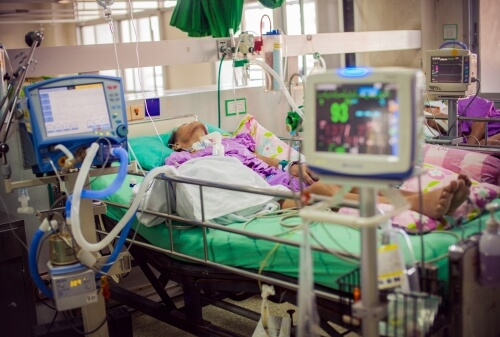 Medical Patient in Hospital Bed on Life Support