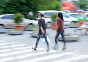 women-walking-in-a-crosswalk-on-a-busy-road Jones Wilson Law Firm