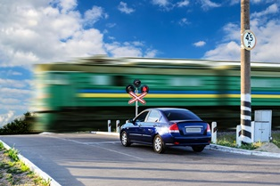 Passing at railroad crossings and reckless driving