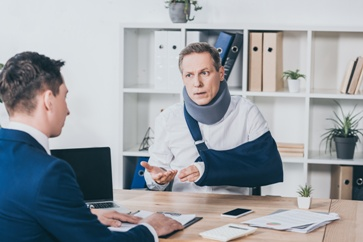 Injured Worker Talking With a Lawyer