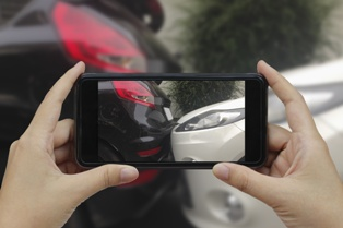 Crash Victim Taking Pictures With a Cell Phone After the Collision