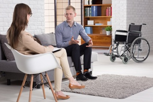 Spinal Cord Injury Victim Talking With a Lawyer