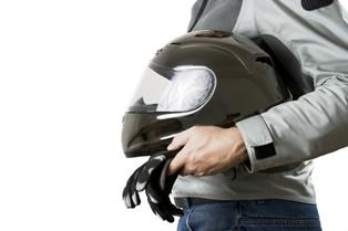 Missouri Motorcyclist Holding a Helmet in His Hands