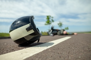 Motorcyclist on Ground With Injuries After a Wreck