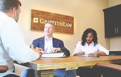 The Brentwood car accident lawyers meeting with a client in conference room