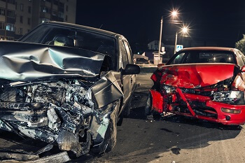 Two severely damaged cars involved in an accident