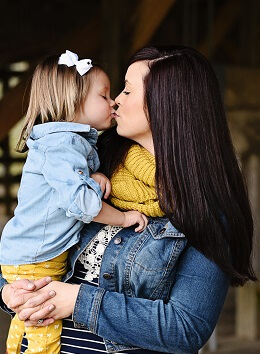 Our client with her young daughter