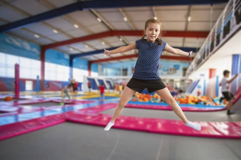 Young girl jumping on trampoline at Jump Zone theme park in Tennessee