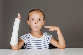 Young girl with growth plate fracture broken bone in wrist