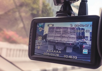 Dash camera in police car recording car and truck accident