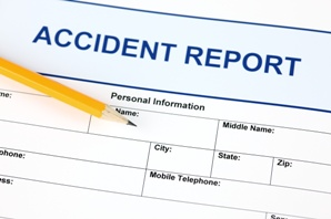 blank accident report form and pencil