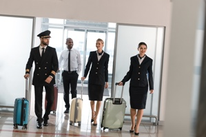 captain flight attendants airline crew walking through airport