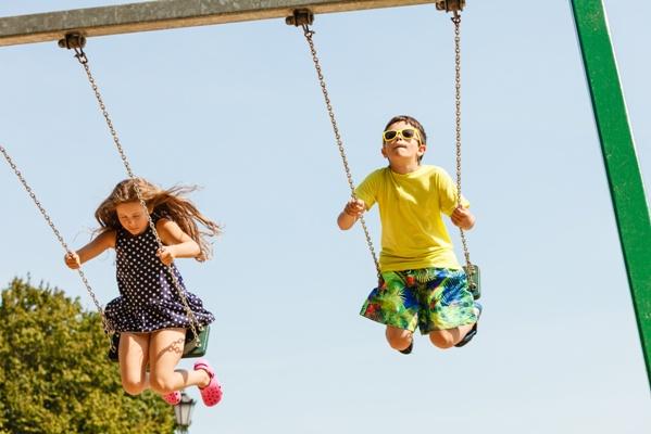 children swinging on playground