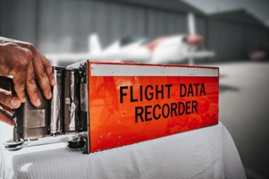 hand holding flight data recorder at airport