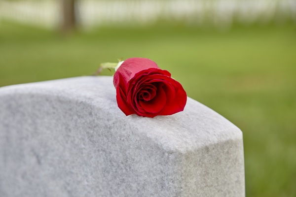 headstone with rose wrongful death