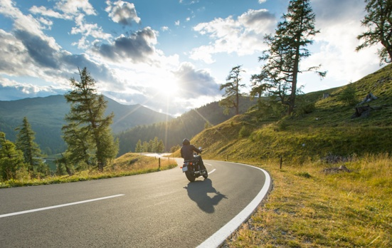 motorcycle rider on mountain road