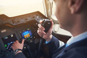 pilot talking to air traffic controller on radio
